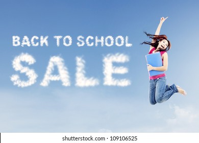 Female college student jumps on the side of clouds spelling out back to school sale