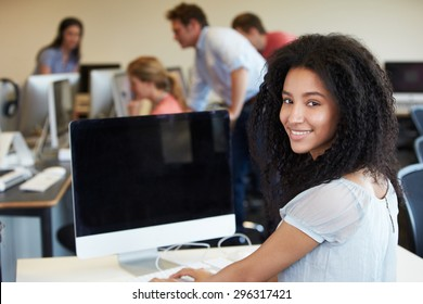 Female College Student Using Computer In Classroom