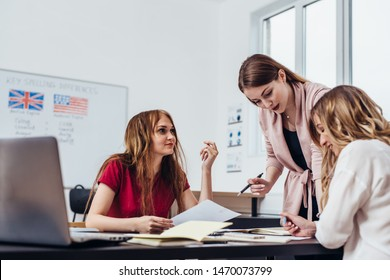 Female college students in classroom. School study learn class