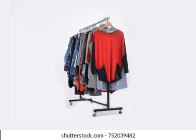 female colorful clothes and coat sundress ,shirts on Hangers-white background