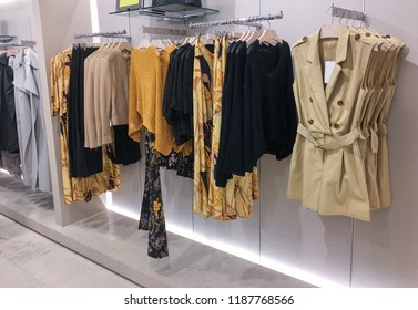 female colorful clothing ,pants ,shoes, handbag set of on the racks in clothing store