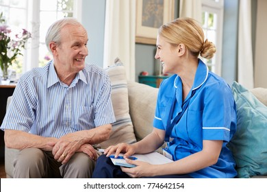 Female Community Nurse Visits Senior Man At Home
