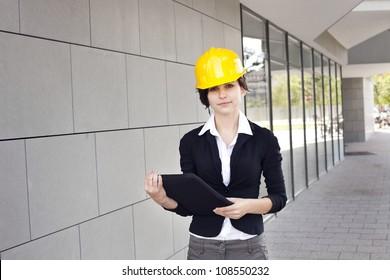 Female construction engineer and yellow helmet