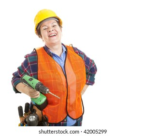 Female construction worker happy and smiling, holding her power drill.  Isolated on white.