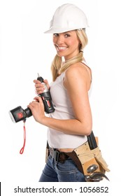 Female construction worker in a hard hat and tool belt with a cordless screwgun