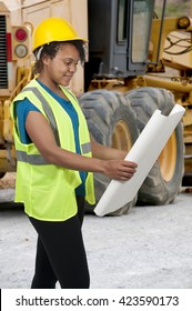 Female Construction Worker on a job site