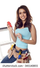 Female construction worker on a ladder over a white background.