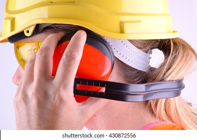A female construction worker with personal safety equipment
