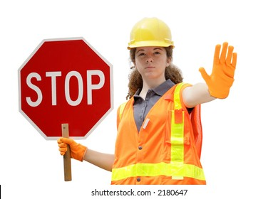 A female construction worker wearing reflective vest & holding a stop sign - isolated.
