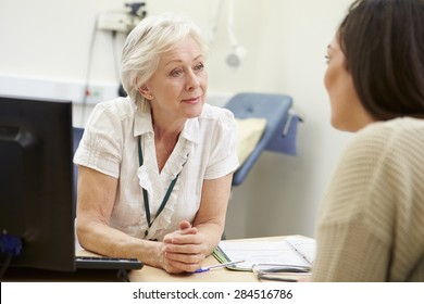 Female Consultant Meeting With Teenage Patient
