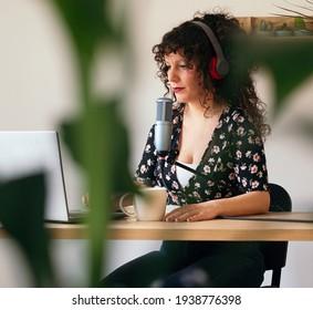Female content creator recording a radio show.Record a podcast