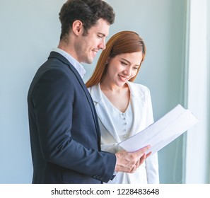 Female contractor is showing her boss the real estate building plan
