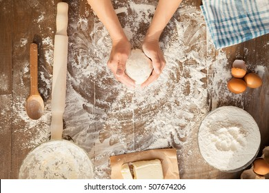 Female cooking dough. View from above.