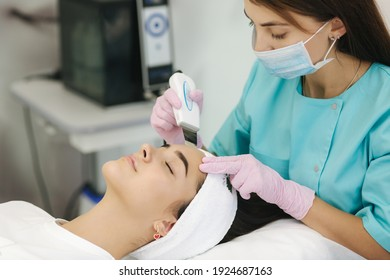 Female at cosmetic beauty spa clinic has facial hardware cosmetology. Woman making beauty procedures