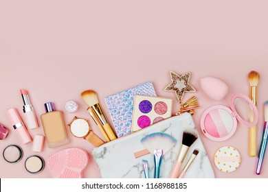 Female cosmetics collage with lipstick, brush and other accessories on pink background. Flat lay, top view.