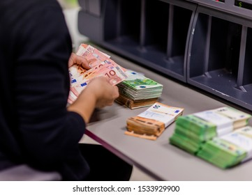 Female counting money Euro € banknote of treasury department for cash machine refill