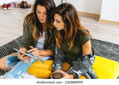 Female couple looking at digital tablet