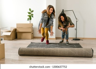 Female couple moving into a new apartment