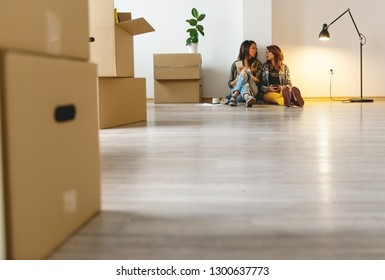 Female couple moving in together