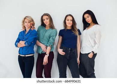 Female coworkers standing together