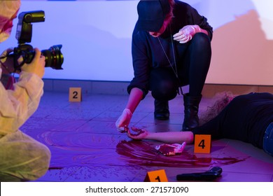 Female criminalist working on a crime scene