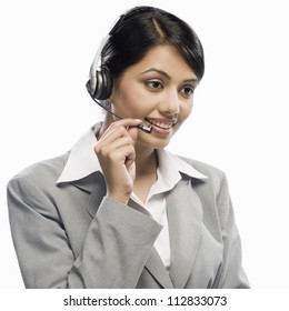 Female customer care executive wearing a headset against a white background