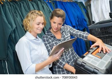 female customer choosing the right uniform