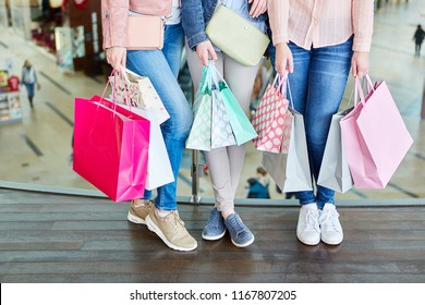 Female customer with many shopping bags in shopping mall