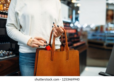 Female customer with purchase in the makeup shop
