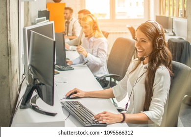 Female customer services agent with Headset working in a call center