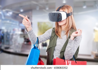 Female customer shopping online by VR headset glasses of virtual reality
