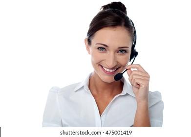 Female customer support executive adjusting her headphone.