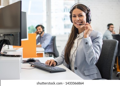 Female customer support operator working in call center. Help and technical support concept.