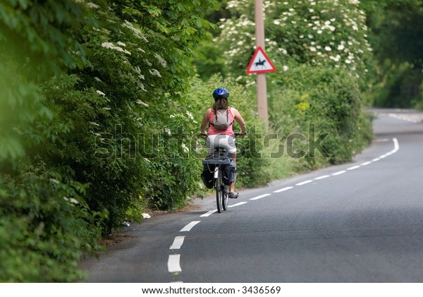 Female cyclist in country lane