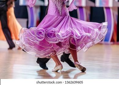 female dancer in mauve dress in dancesport standard program
