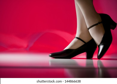 Female Dancer's Feet in Character Shoes (Pink Background)