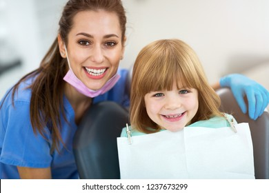 Female dentist and child in a dentist office