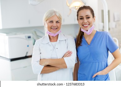 Female dentist and dental assistant in office