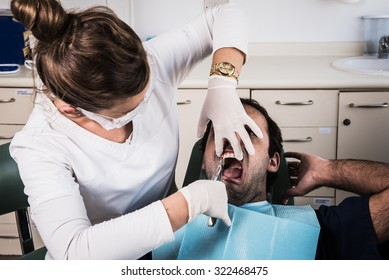 Female dentist in her clinic with a patient.