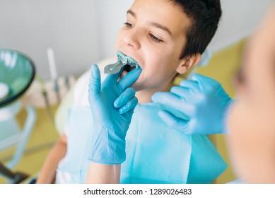 Female dentist makes teeth impression
