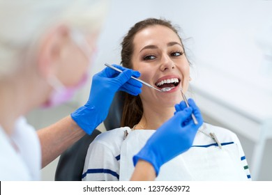 Female dentist and patient in dentist office