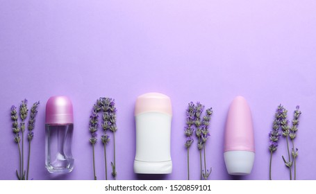Female deodorants and lavender flowers on lilac background, flat lay