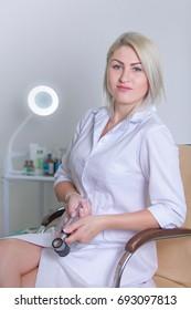 Female Dermatologist with dermatoscope