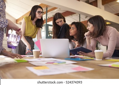 Female Designers Having Brainstorming Meeting In Office
