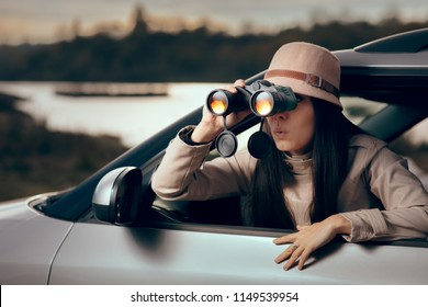 Female Detective Spying with Binocular from a Car. Secret agent private investigator looking for evidence in infidelity case