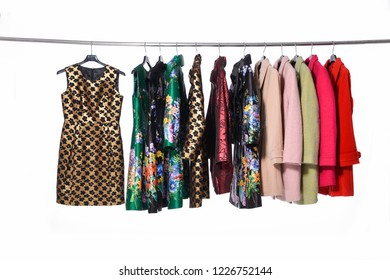 female different  coat clothing ,with floral sundress, on hanger