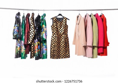 female different  colorful coat clothing ,with floral sundress, on hanger