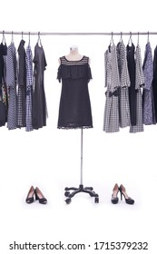 female different stripy sundress on hanger and mannequin in female fashion striped pattern sundress, and two black high hell shoes