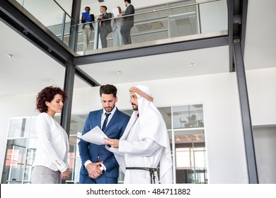 Female director of company and her manager have meeting with middle East partner