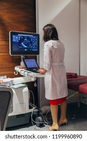Female doctor analyses results of ultrasound scan of human heart. Sonography diagnostics